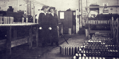 "With many men at the front, women stepped up to ""do their bit"" on farms and in factories such as this munitions plant."