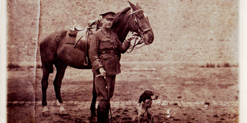 "John McCrae, writer of ""In Flanders Fields,"" stands beside his horse, Bonfire, and his dog, Bonneau. The dog would often accompany McCrae, as he tended to wounded soldiers."